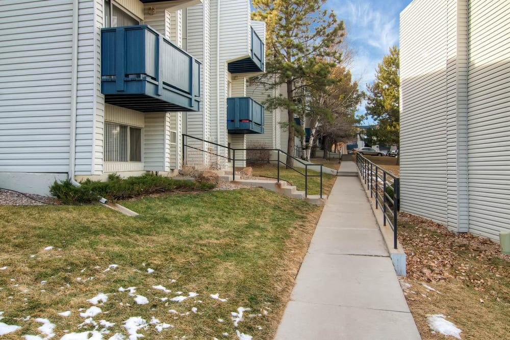 Path past apartments with balcony  at Arvada Green Apartment Homes in Arvada, Colorado