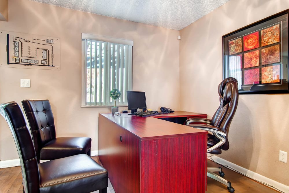 Leasing office desk and chairs at Arvada Green Apartment Homes in Arvada, Colorado
