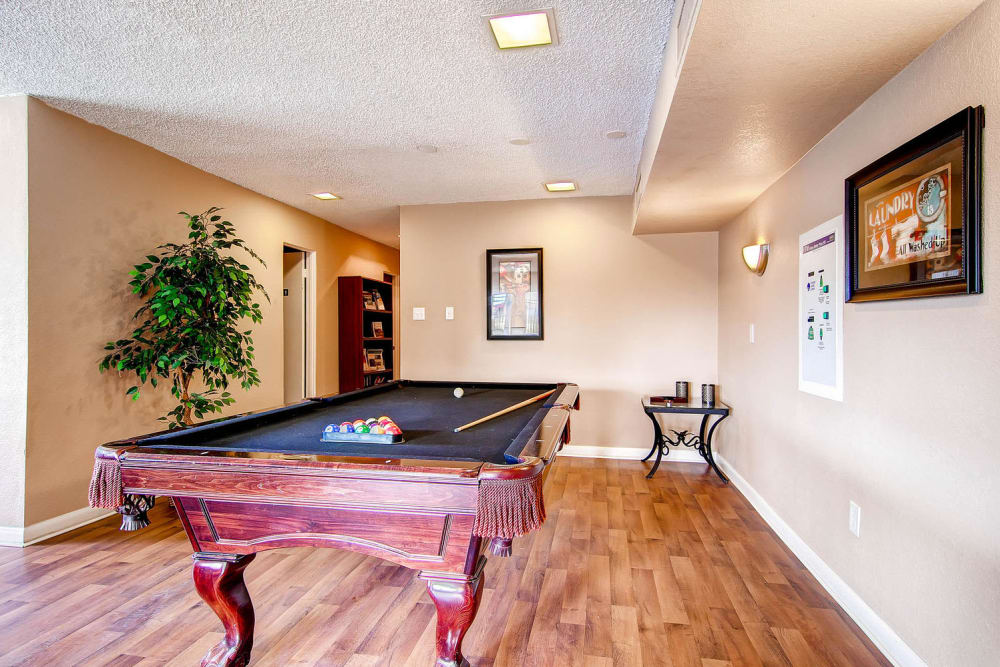 A billiards table in the game room area of the clubhouse at Arvada Green Apartment Homes in Arvada, Colorado