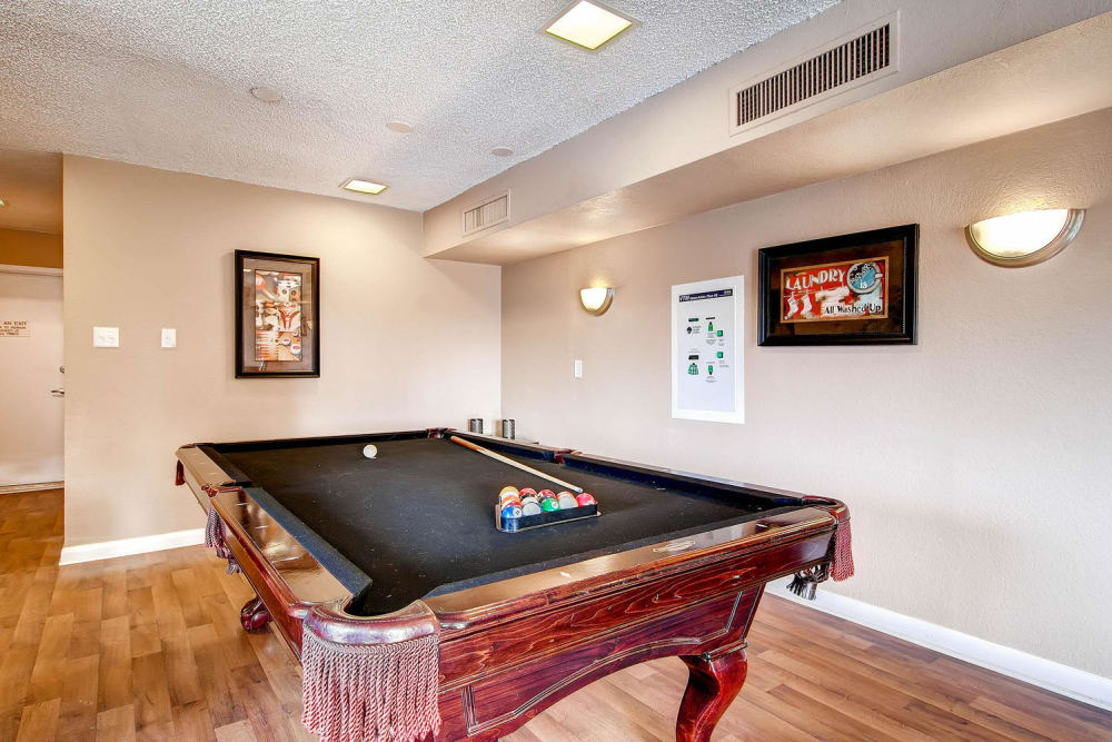 a billiards table in the clubhouse at Arvada Green Apartment Homes in Arvada, Colorado