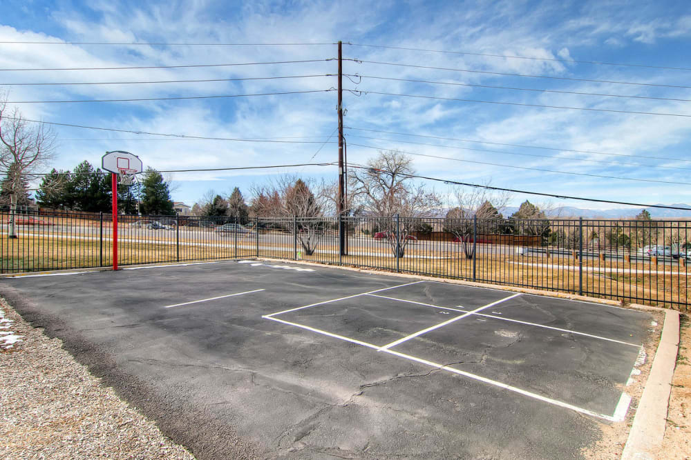 Asphalt playing court located at Arvada Green Apartment Homes in Arvada, Colorado