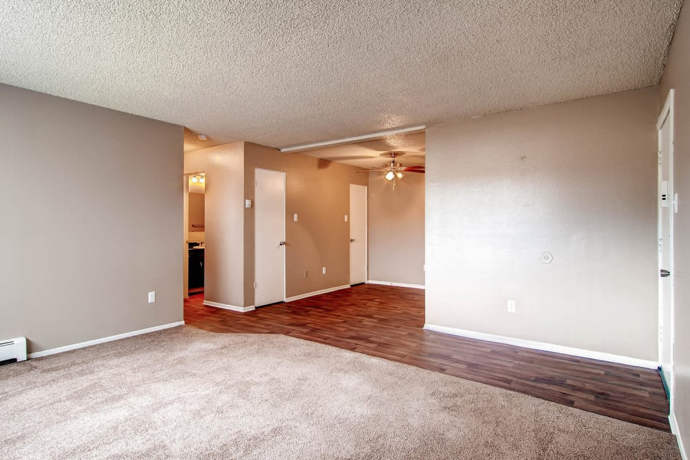 spacious living room and entryway to an apartment at Arvada Green Apartment Homes in Arvada, Colorado