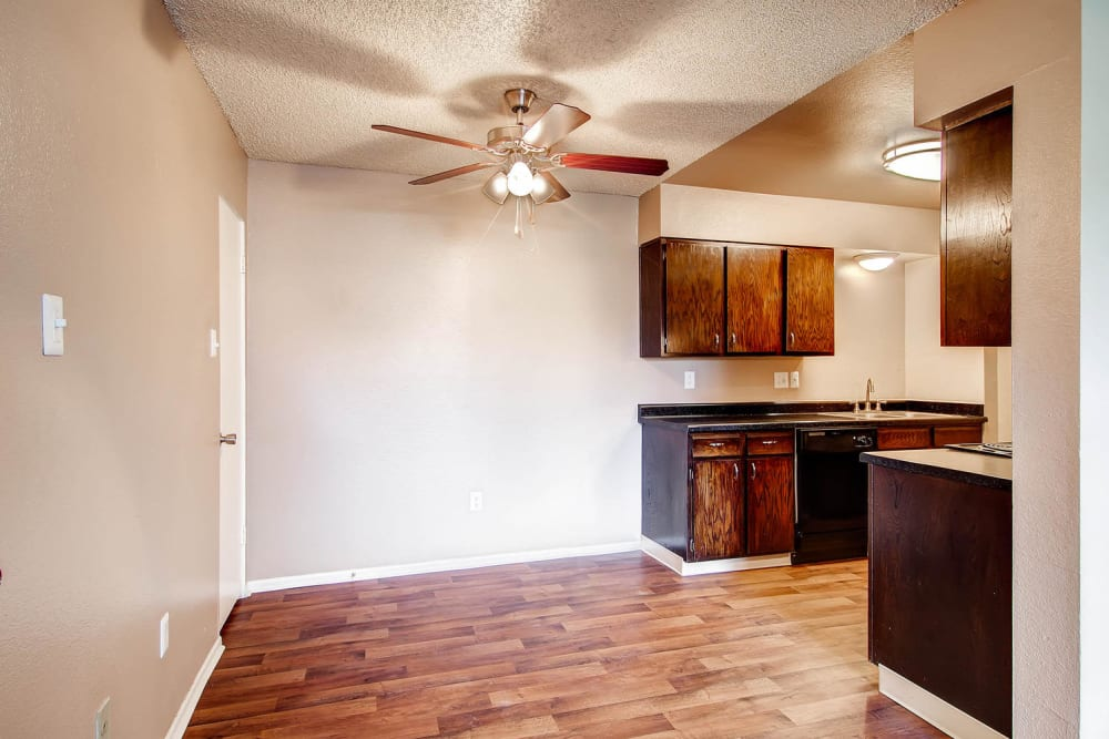 Do you have dining space and kitchen area featuring black appliances at Arvada Green Apartment Homes in Arvada, Colorado