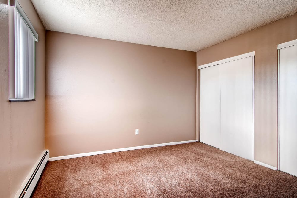 Comfortable size bedroom in an apartment at Arvada Green Apartment Homes in Arvada, Colorado