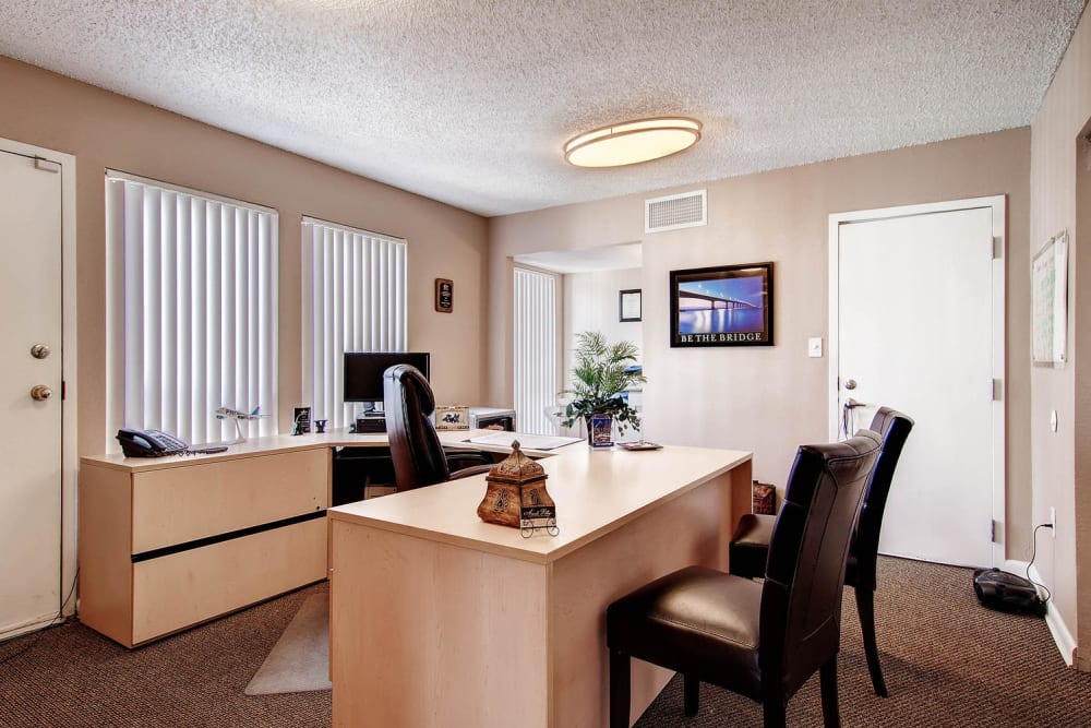 Leasing office with desk and chairs at Apartments in Arvada, Colorado