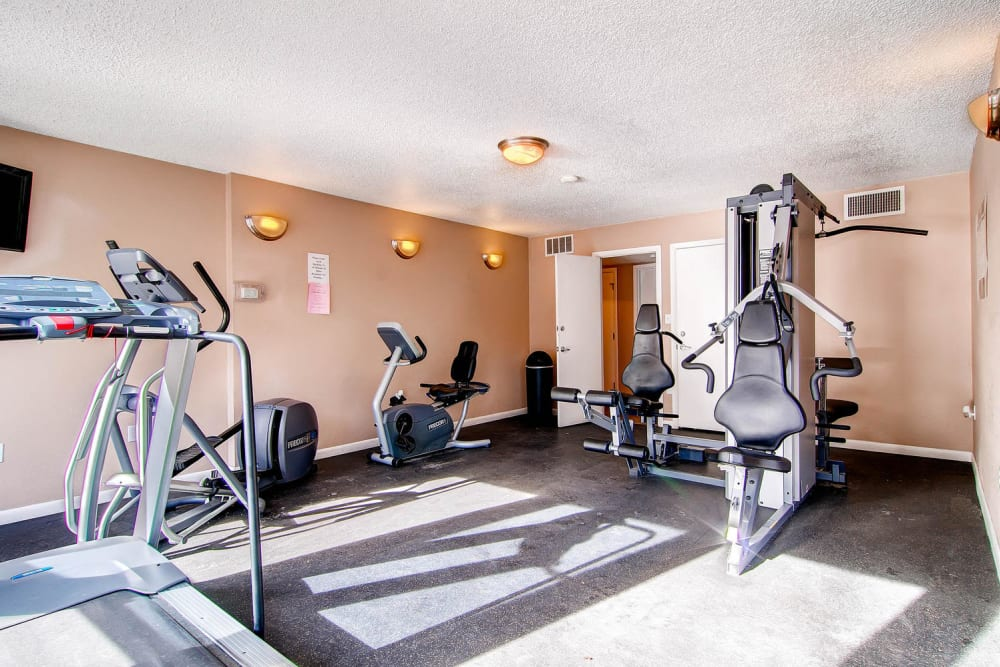 Fitness center with a variety of workout equipment at Apartments in Arvada, Colorado