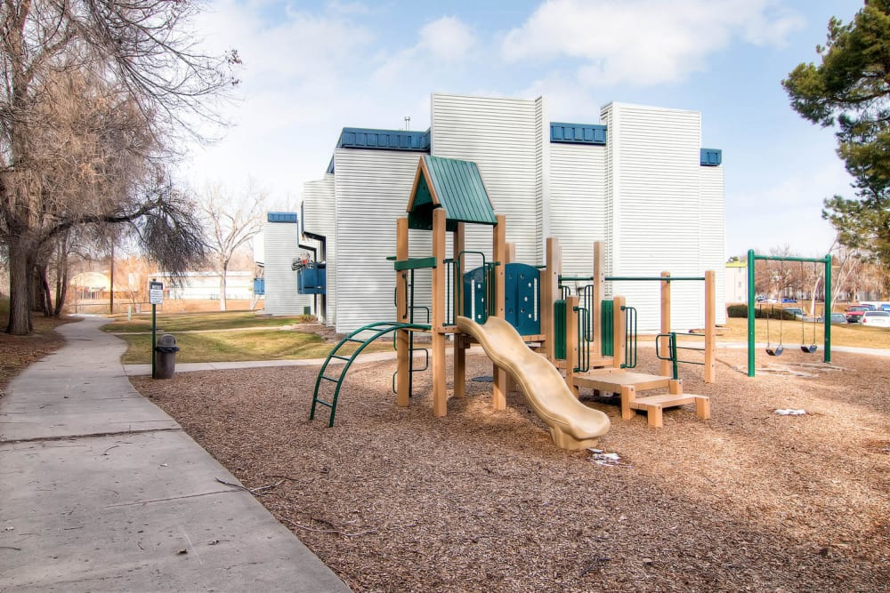 Play ground equipment and walkway path at Apartments in Arvada, Colorado