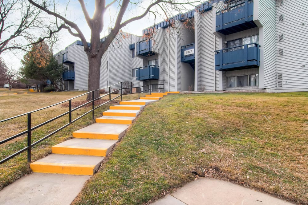 Stairs leading to apartments at Arvada Village Apartment Homes in Arvada, Colorado