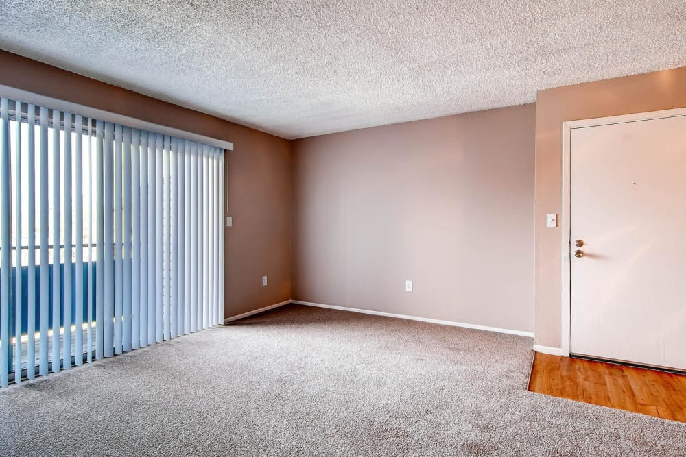 Sliding glass doors leading from living room to outdoors in at Arvada Village Apartment Homes in Arvada, Colorado