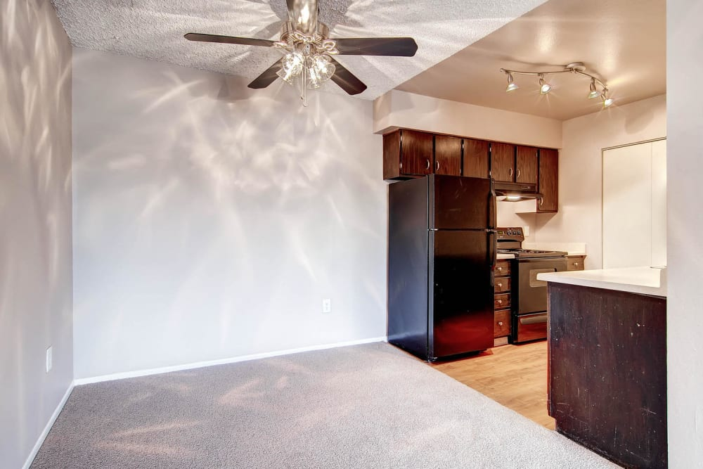Dining space featuring a ceiling fan off of kitchen in an apartment at Arvada Village Apartment Homes in Arvada, Colorado