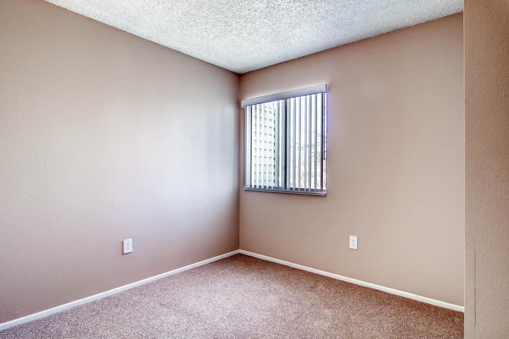 Cozy bedroom in an apartment at Arvada Village Apartment Homes in Arvada, Colorado