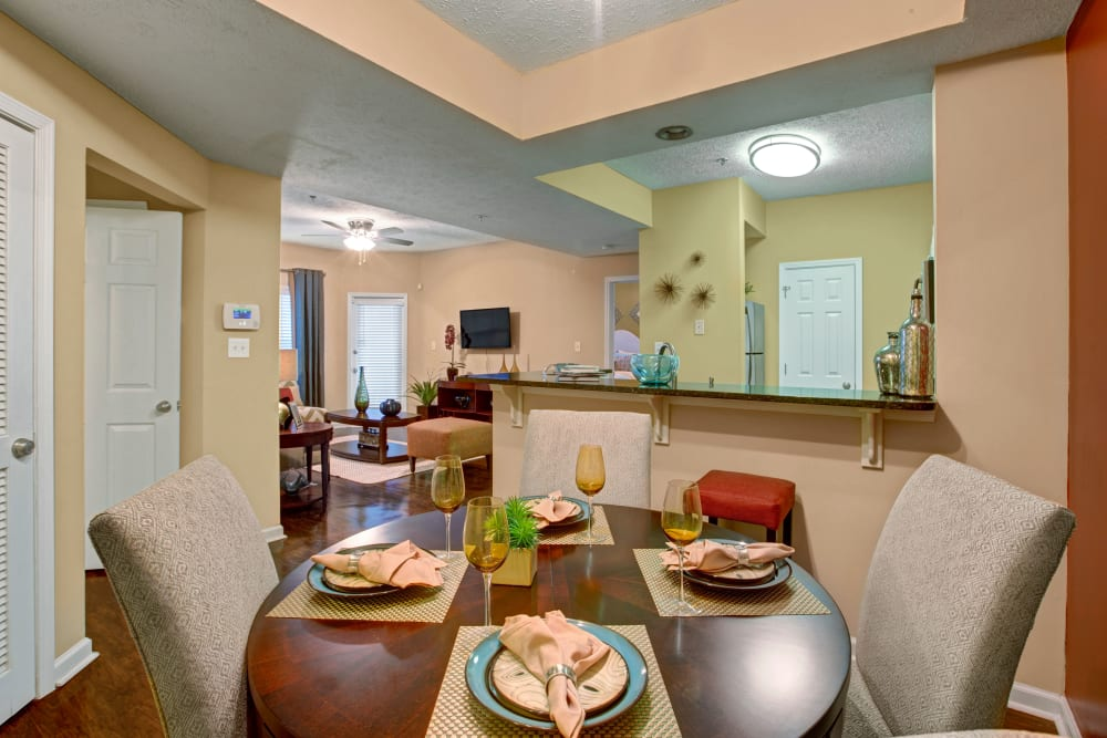 Dining room with a view of kitchen and living room and well furnished apartment at Avia at North Springs in Atlanta, Georgia