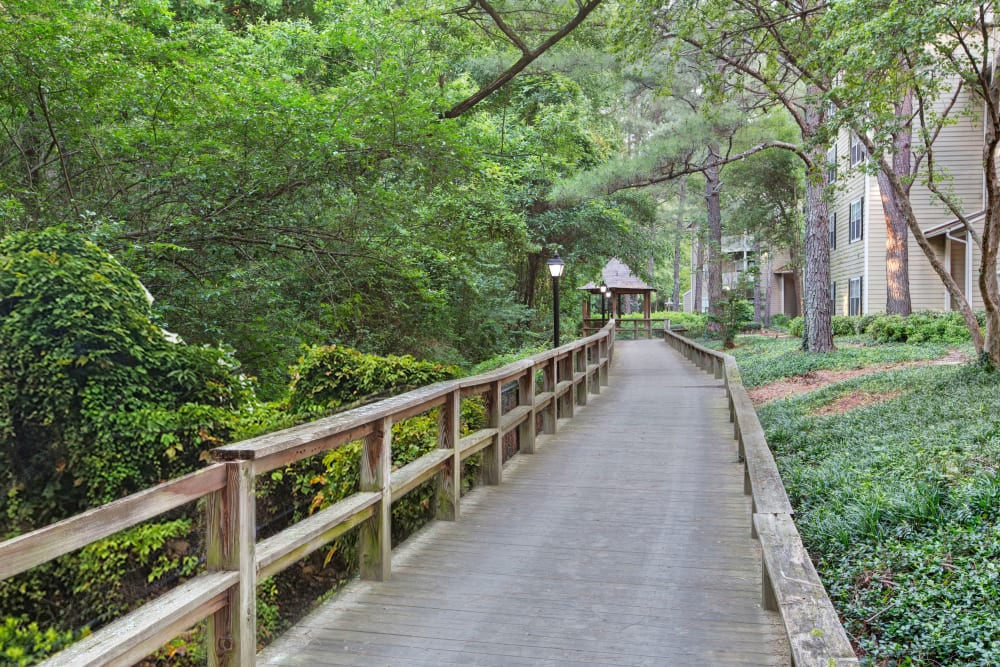 Walking paths with green space at Avia at North Springs in Atlanta, Georgia