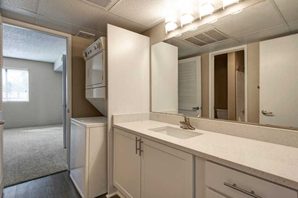 Lots of bathroom countertop space and storage in this brightly lit bathroom located in an Apartment at Avia McCormick Ranch Apartments in Scottsdale, Arizona