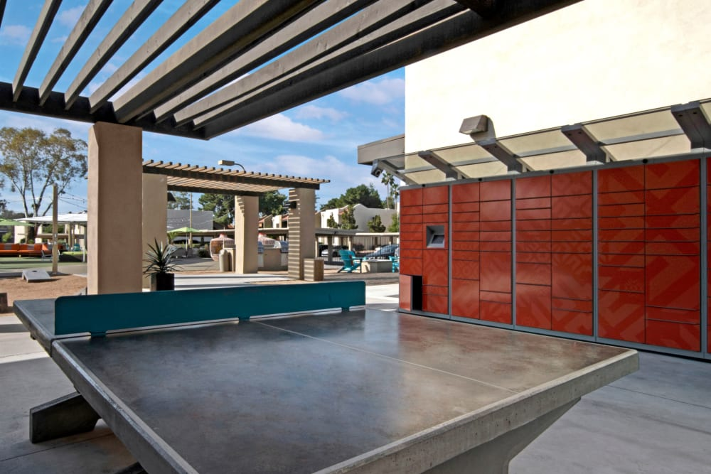 Outdoor shade area featuring a ping pong table at Avia McCormick Ranch Apartments in Scottsdale, Arizona