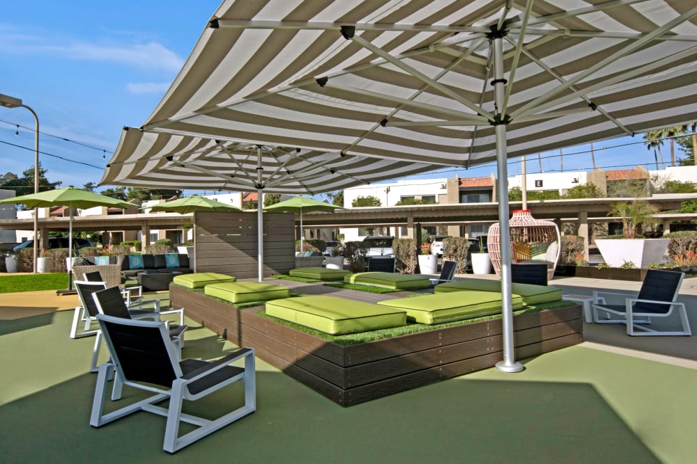 Large sunshade umbrella and outdoor seating area at Avia McCormick Ranch Apartments in Scottsdale, Arizona