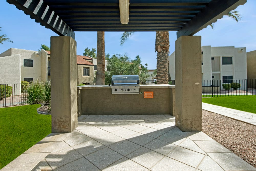 Covered outdoor grilling station at Avia McCormick Ranch Apartments in Scottsdale, Arizona
