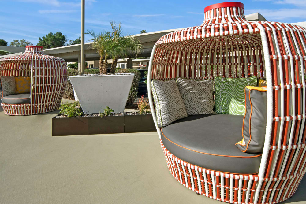 Playful and unique poolside seating pads for shade at Avia McCormick Ranch Apartments in Scottsdale, Arizona