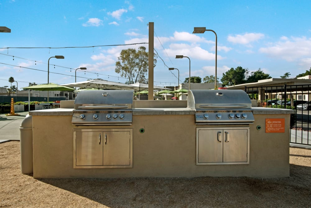 Double outdoor grilling station on the outdoor patio at Avia McCormick Ranch Apartments in Scottsdale, Arizona