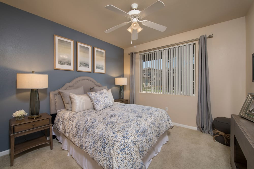 Main bedroom with a large window for natural lighting at Esplanade Apartment Homes in Riverside, California