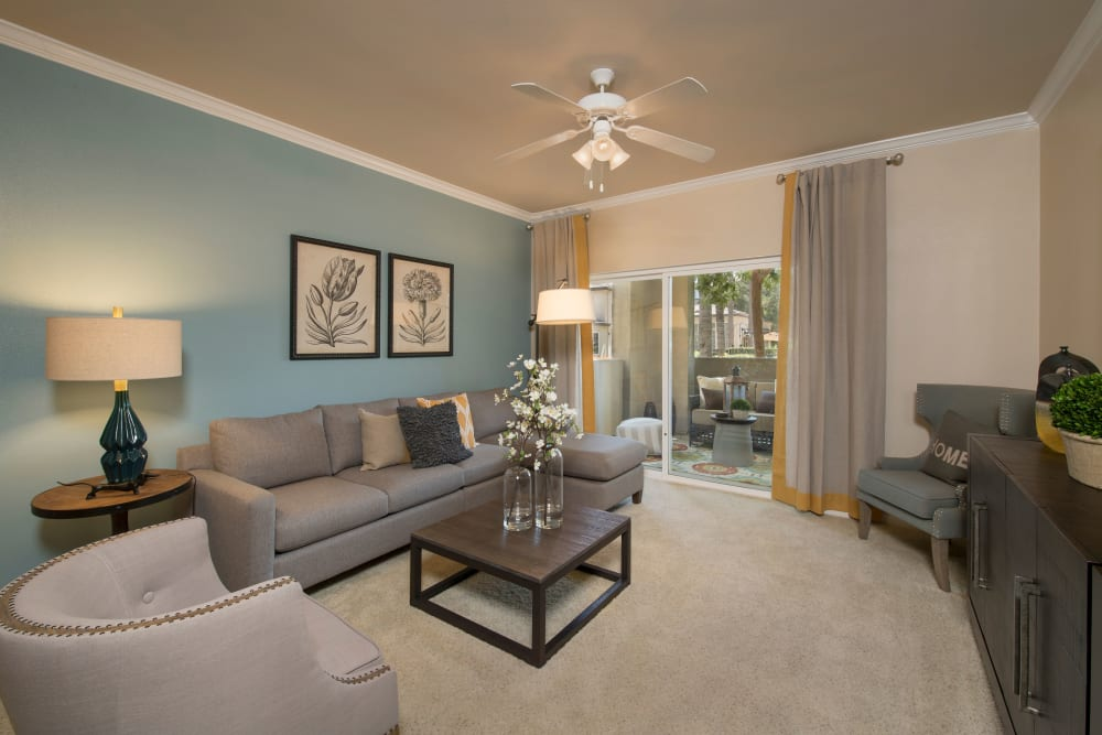 A living room in a model home at Esplanade Apartment Homes in Riverside, California