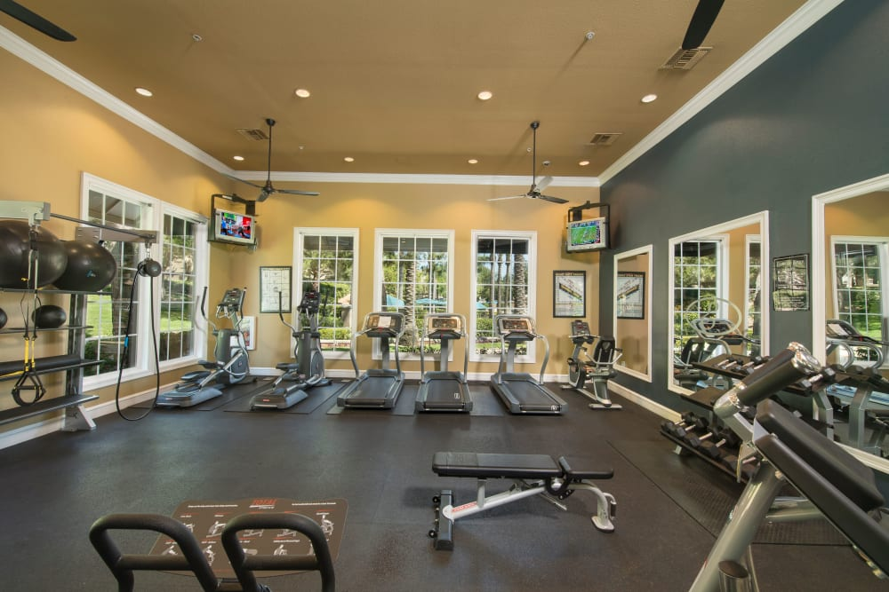 Gym with plenty of individual workout stations at Esplanade Apartment Homes in Riverside, California