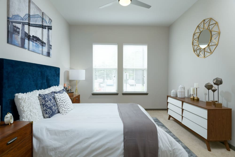 Spacious bedroom with large windows at Bluebird Row in Chattanooga, Tennessee