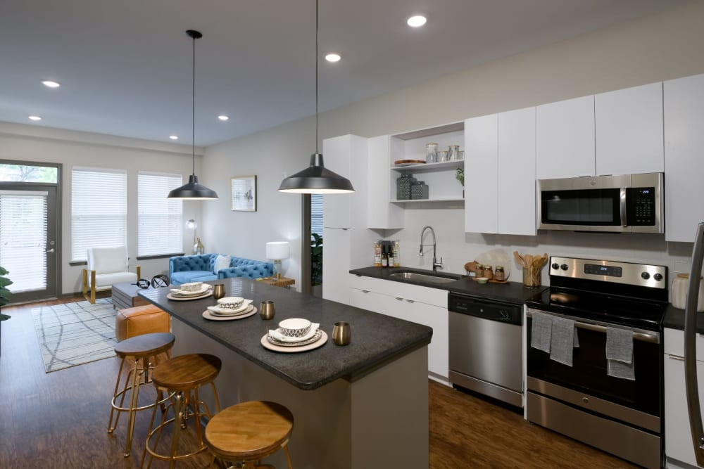 Kitchen and living room in open-concept layout at Bluebird Row in Chattanooga, Tennessee