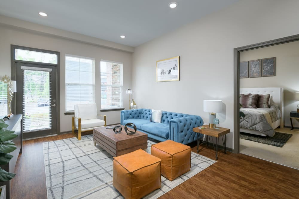 Spacious living room with wood-style flooring, two-tone paint, and recessed lighting at Bluebird Row in Chattanooga, Tennessee
