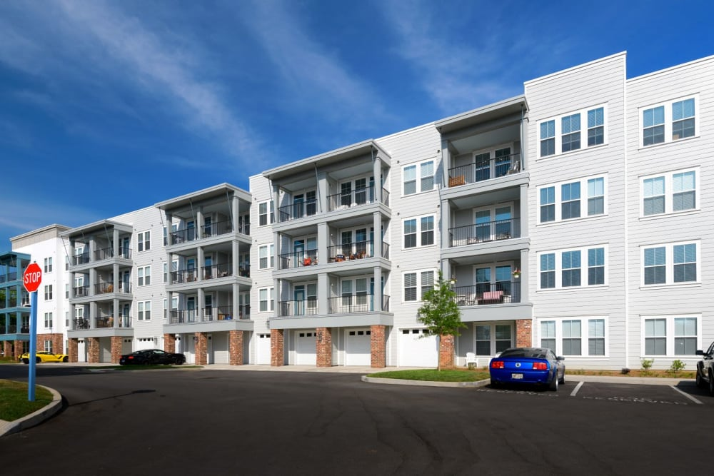 Photo of rear, exterior building with garages on first floor at Bluebird Row in Chattanooga, Tennessee