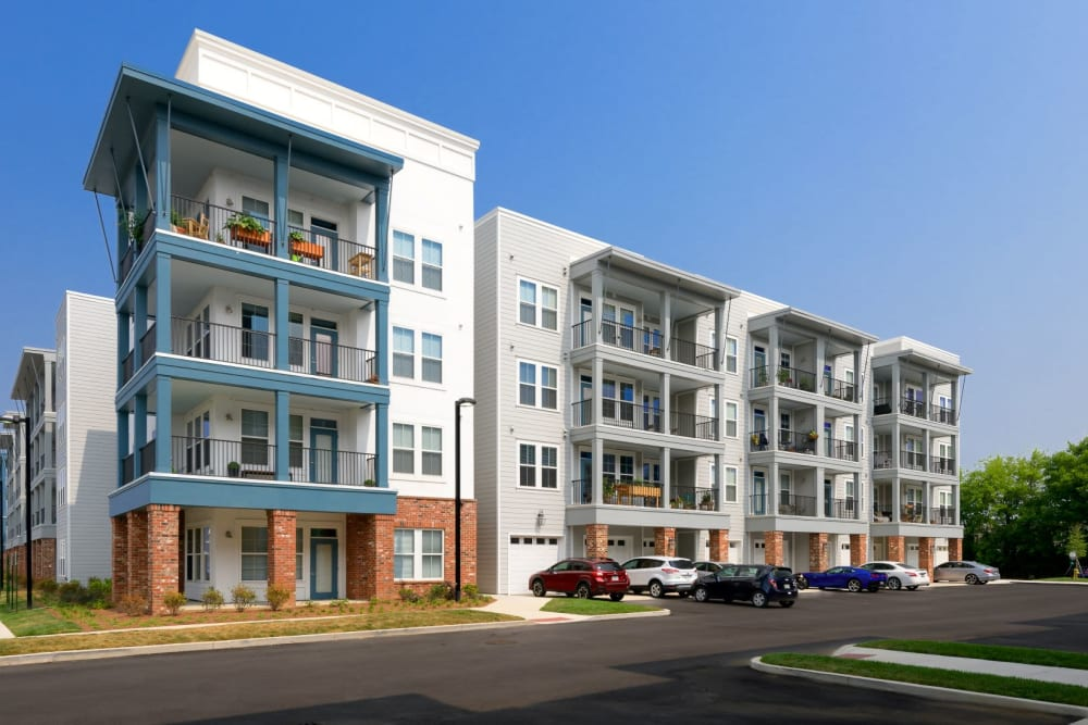 Daytime exterior image of building with blue accent patios at Bluebird Row in Chattanooga, Tennessee