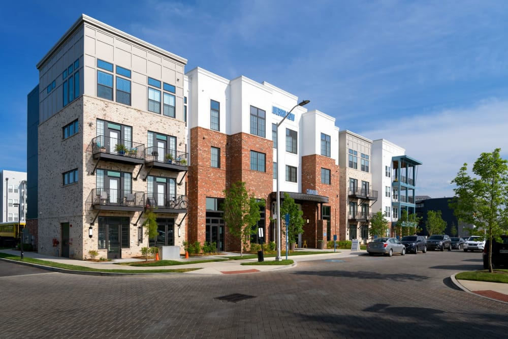 Daytime exterior image of building with brick accents Bluebird Row in Chattanooga, Tennessee