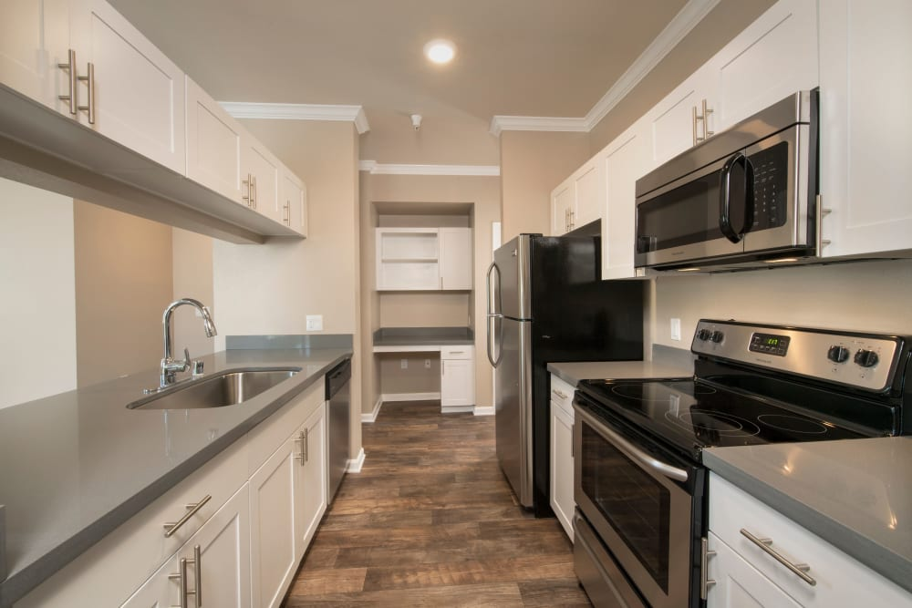A luxury kitchen with plenty of counter space for holiday celebrations at Esplanade Apartment Homes in Riverside, California