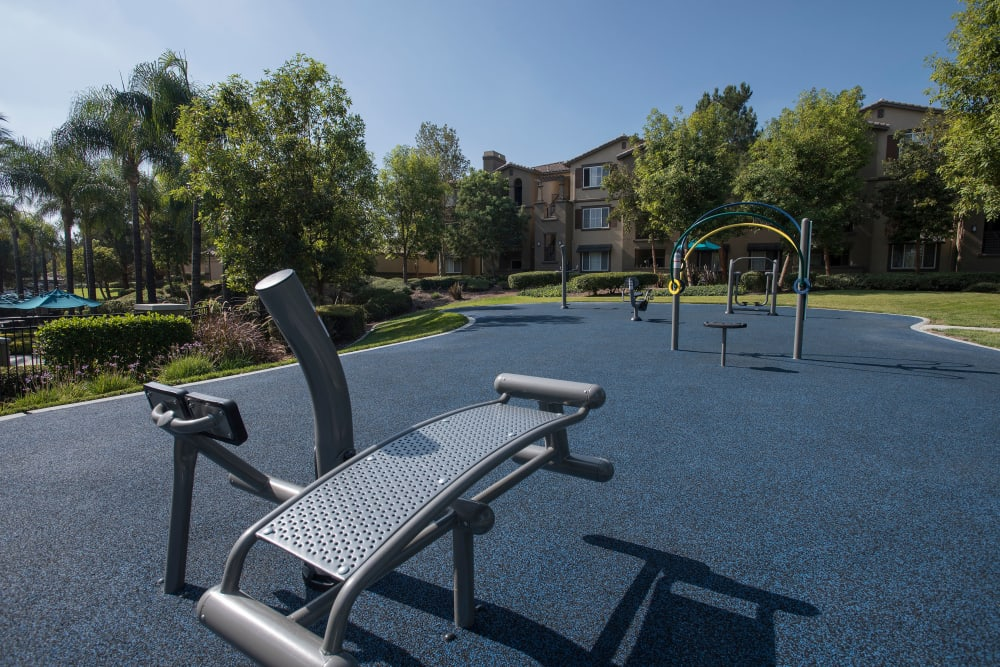 Outdoor fitness area for summer workout sessions at Esplanade Apartment Homes in Riverside, California