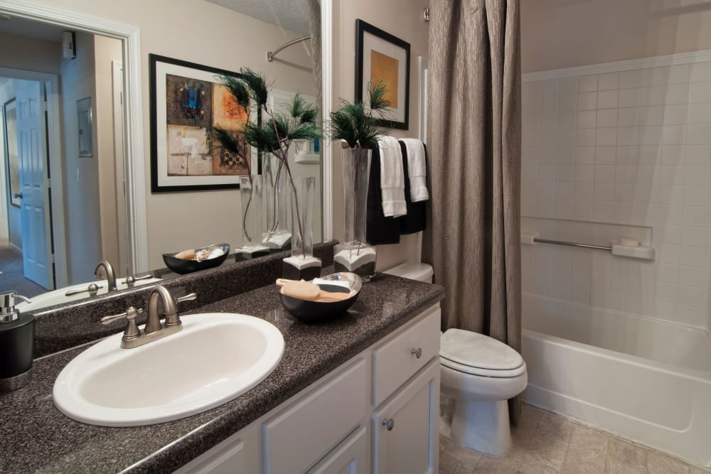 Nicely decorated bathroom featuring a shower and bathtub at Bellingham Apartment Homes in Marietta, Georgia