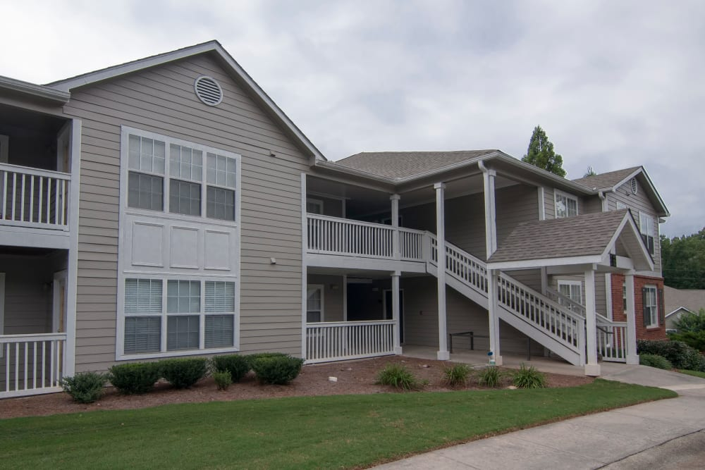 Building exterior with grassy lawn at Bellingham Apartment Homes in Marietta, Georgia