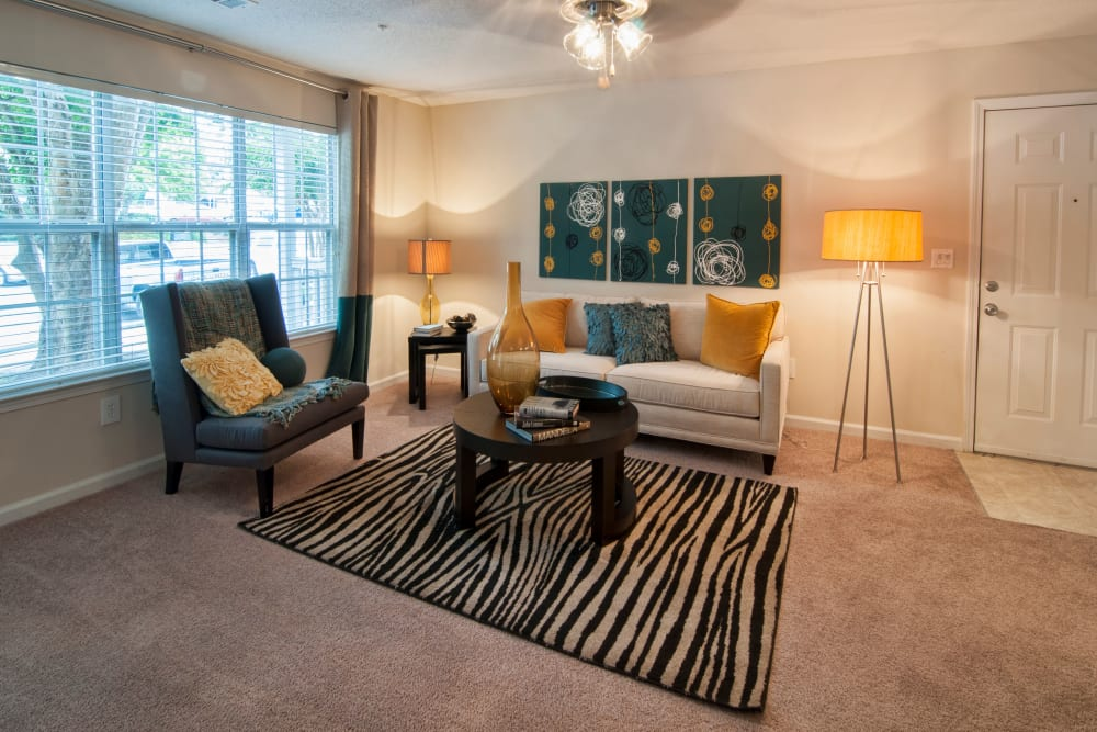 Living room interior decorate it with modern furnishings window to allow lots of natural light in an apartment at Bellingham Apartment Homes in Marietta, Georgia