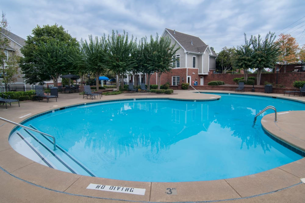 Outdoor community swimming pool at Bellingham Apartment Homes in Marietta, Georgia