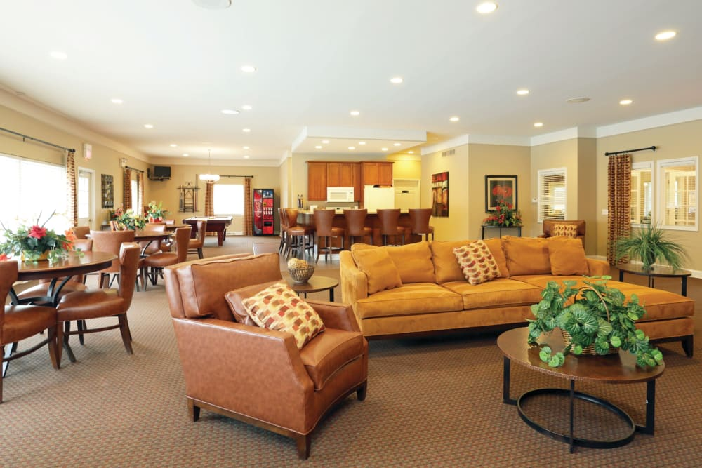 He finally finished clubhouse featuring couch seating tables and chairs and more at Blackhawk Apartments in Elgin, Illinois