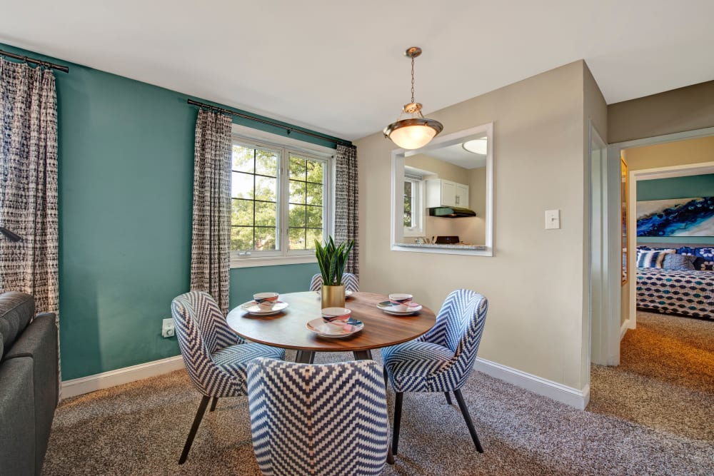Dining table with overhead light at Braddock Lee Apartments in Alexandria, Virginia