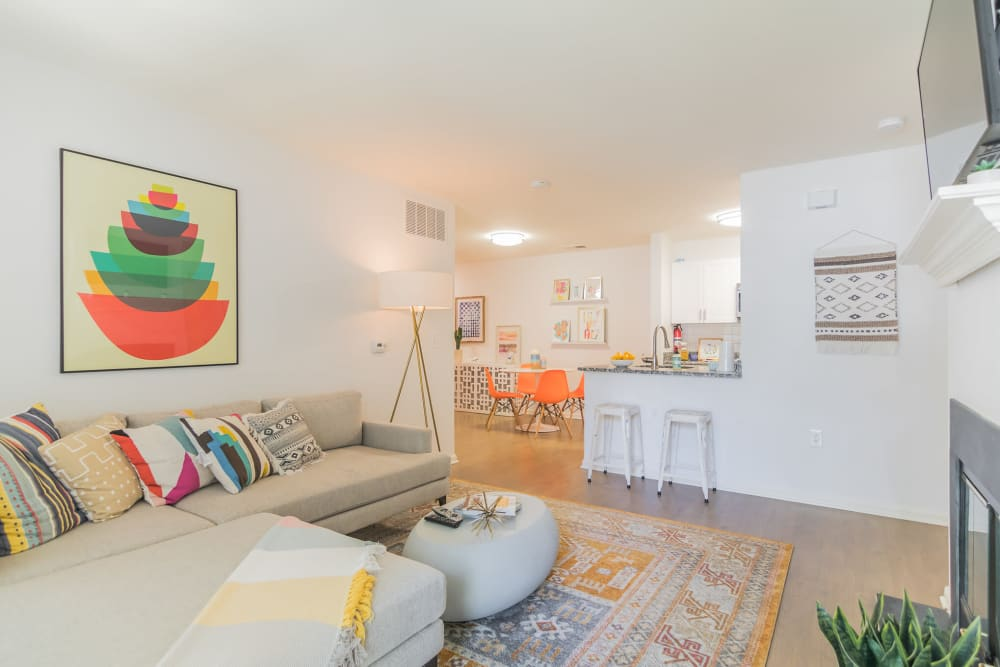 Living room and kitchen with breakfast bar seating in an apartment at Eagle Rock Apartments at Freehold in Freehold, New Jersey
