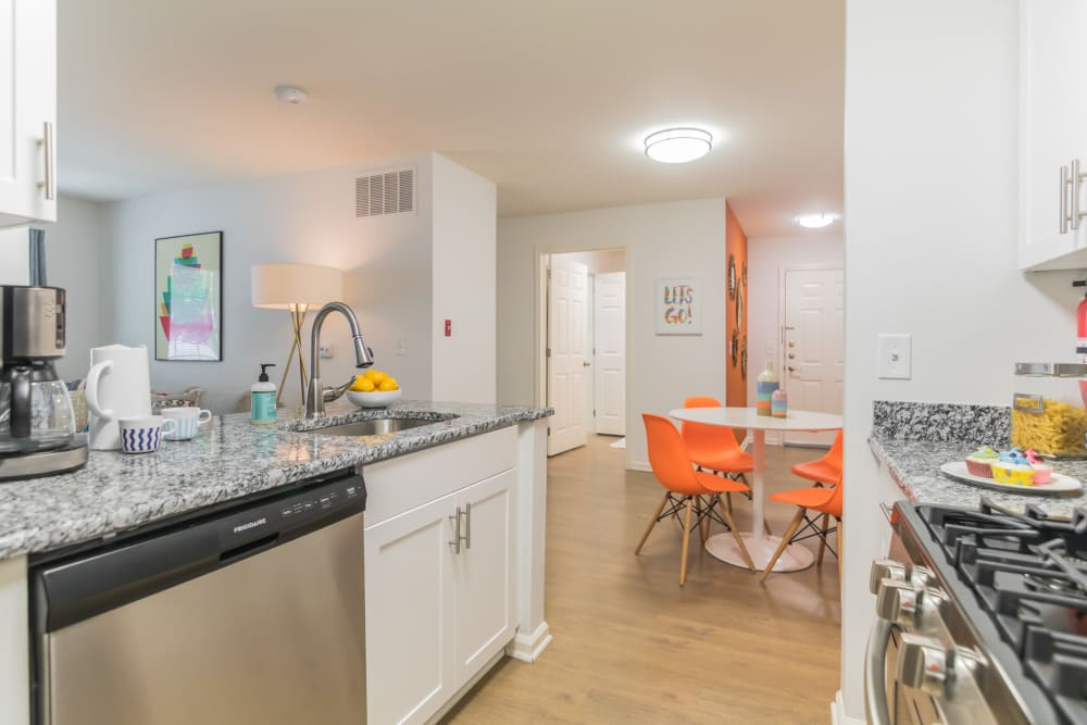 Modern kitchen with stainless steel appliances and plenty of counter space in an apartment at Eagle Rock Apartments at Freehold in Freehold, New Jersey