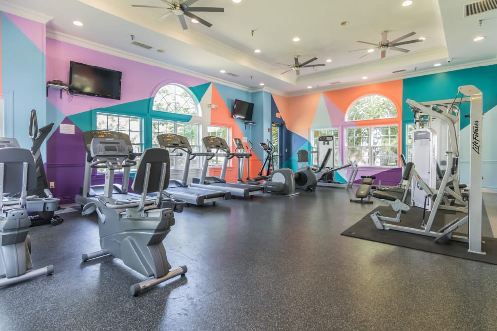 Modern workout equipment in the fitness center at Eagle Rock Apartments at Freehold in Freehold, New Jersey