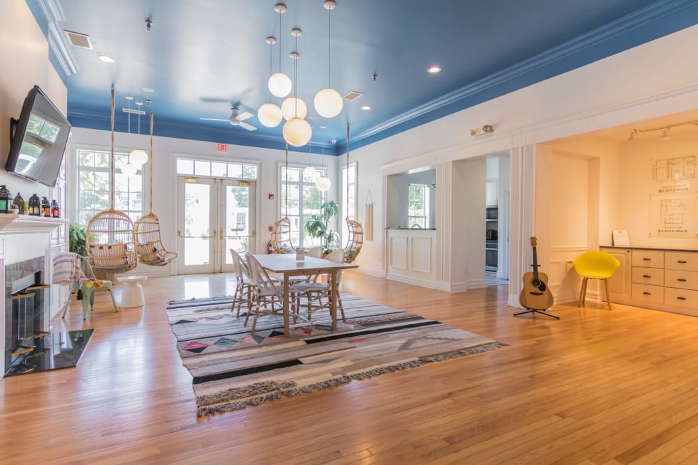 Clubhouse interior featuring seating areas, hardwood floors and modern Decor at Eagle Rock Apartments at Freehold in Freehold, New Jersey