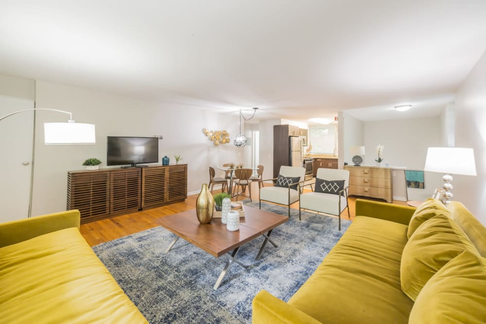 Living room featuring open floor plan format highlights lots of space in an apartment at Cherokee Apartments in Philadelphia, Pennsylvania