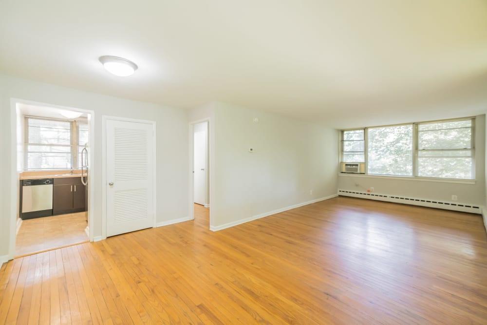 Spacious open floor plan living room featuring hardwood floors in an apartment at Cherokee Apartments in Philadelphia, Pennsylvania
