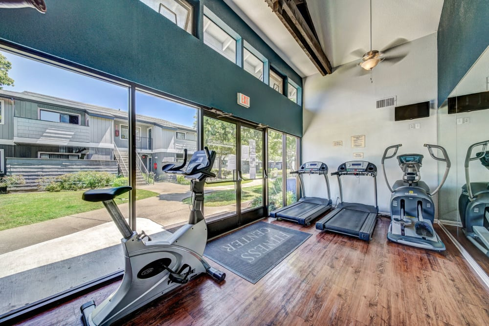 Fitness center with plenty of individual workout stations at Parkside Commons Apartments in San Leandro, California