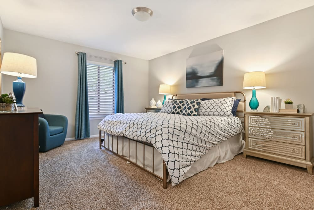 Spacious bedroom with beautiful Decor In an apartment at features stainless steel kitchen appliances  at Crest at Riverside in Roswell, Georgia