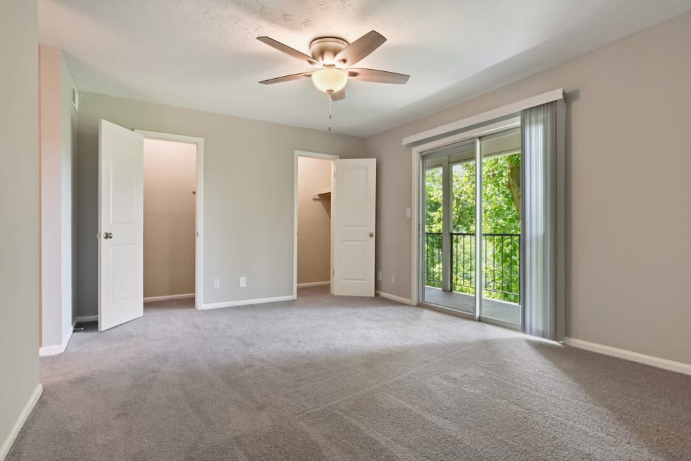 Spacious bedroom with sliding glass door to outside and plenty of closet space In an apartment at Crest at Riverside in Roswell, Georgia