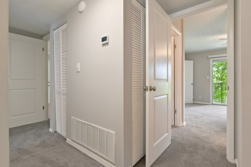 Hallway and view of spacious bedroom at Crest at Riverside in Roswell, Georgia